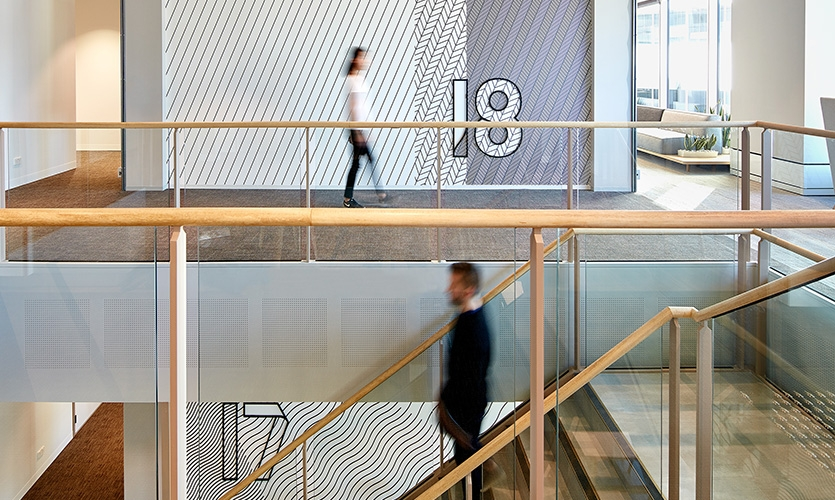 The remodeled workplace called for the development of a series of branded placemaking and signage installations across five levels of their Australia & New Zealand regional hub.