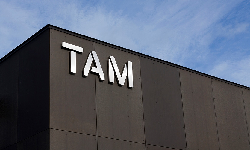 Tacoma Art Museum logo using the custom Alpha TAM typeface.