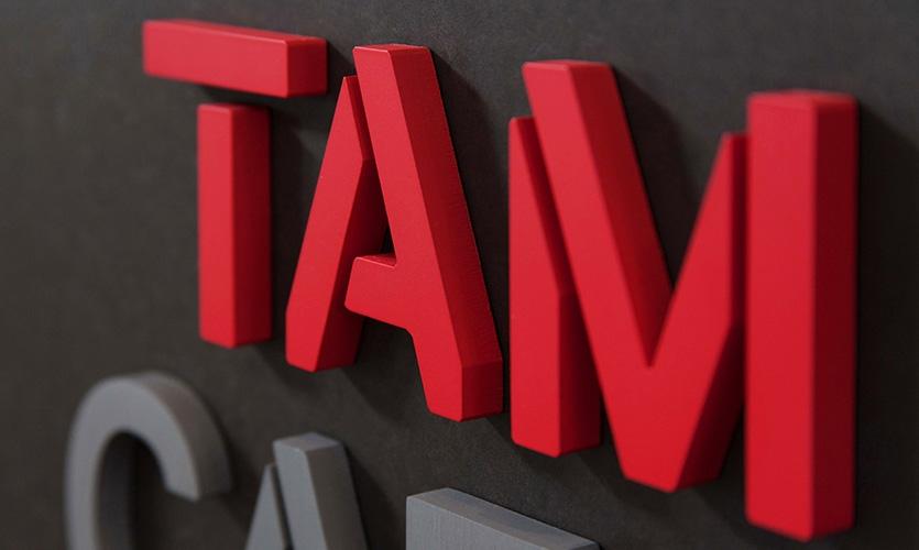 TAM Cafe signage detail.