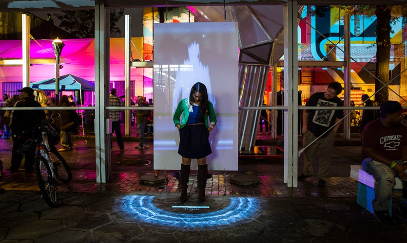 """A guest clears her biometric data using the interactive """"cache wash"""" sign."""