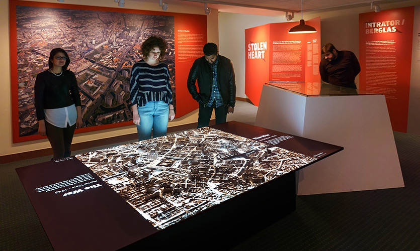 The video map was designed to be integrated with other exhibition elements including panels, artifacts and interactives that outline the journeys of the five families.