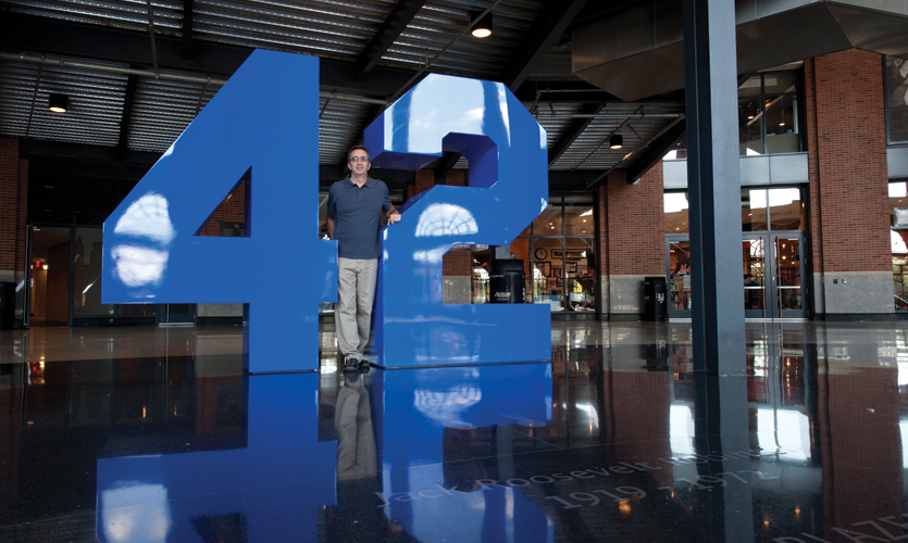 Posing with the 42 sculpture in the Jackie Robinson Rotunda at CitiField ball park, Queens, NY (Two Twelve)
