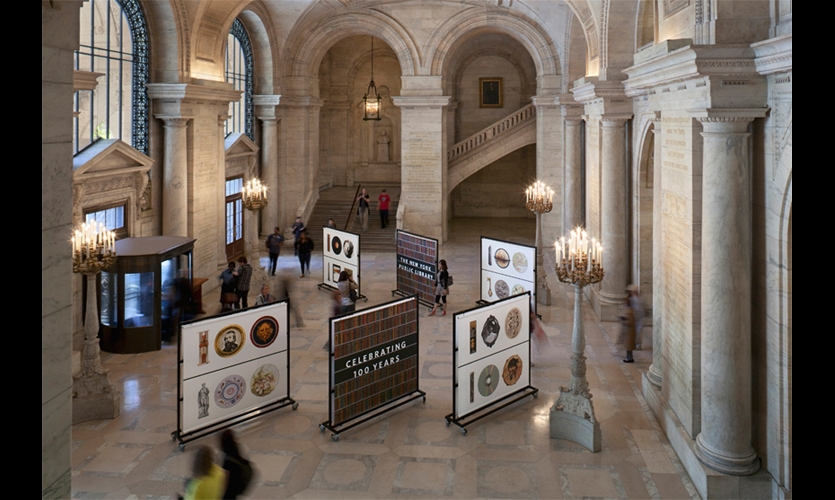 Just inside Astor Hall, the library's landmark entry, six freestanding banners displayed the Celebrating 100 Years identity and pointed the way to the exhibition hall.