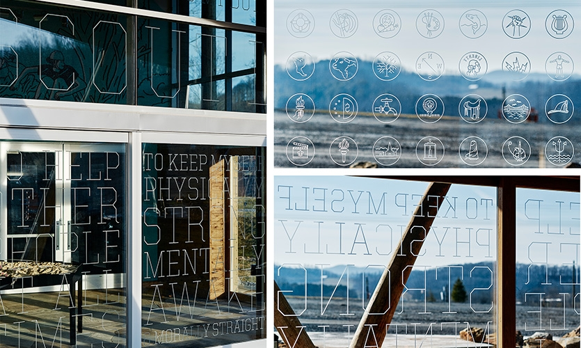 Details of the type and merit badges that are etched into the building's facade.