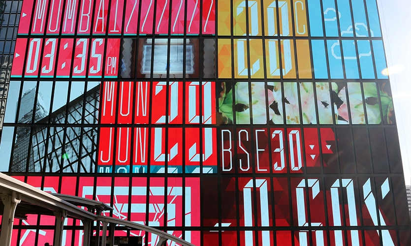 The building's custom screen was built onsite and is divided in cassettes that align with the columns of the building structure, and each cassette is used to accommodate content as a monospace element.