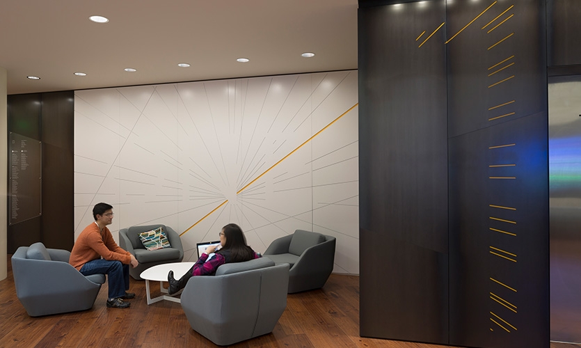 Routed lines in lobby focal walls cut into elevator core steel revealing floor level numerals, referencing neural activity and connections between research groups at the institute.