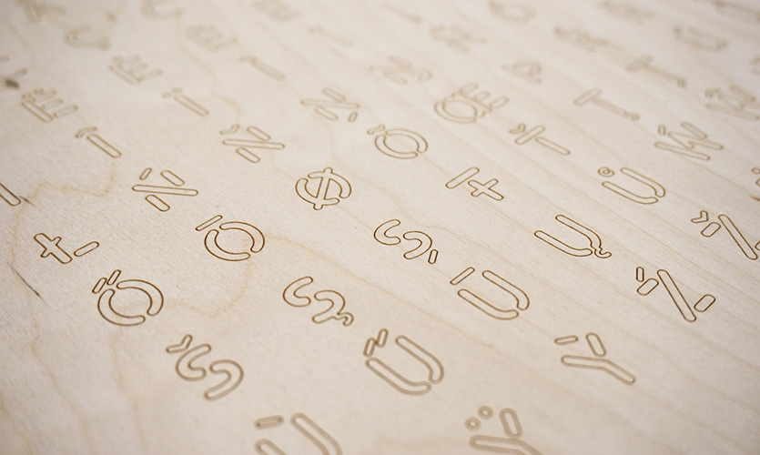 The custom typeface and pictogram set were designed to be environmentally legible and structurally sound when stencil cut. All icons can be cut using the same drill on a CNC machine.