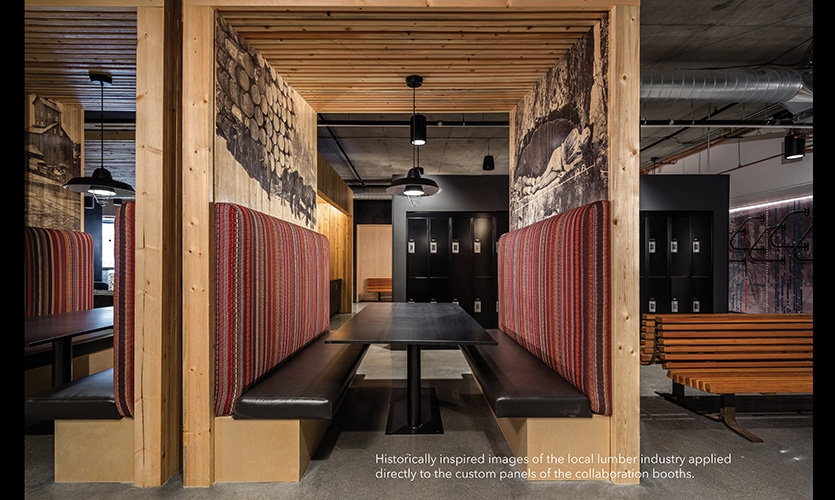 Historically inspired images of the local lumber industry were applied directly to the custom panels of the collaboration booths.