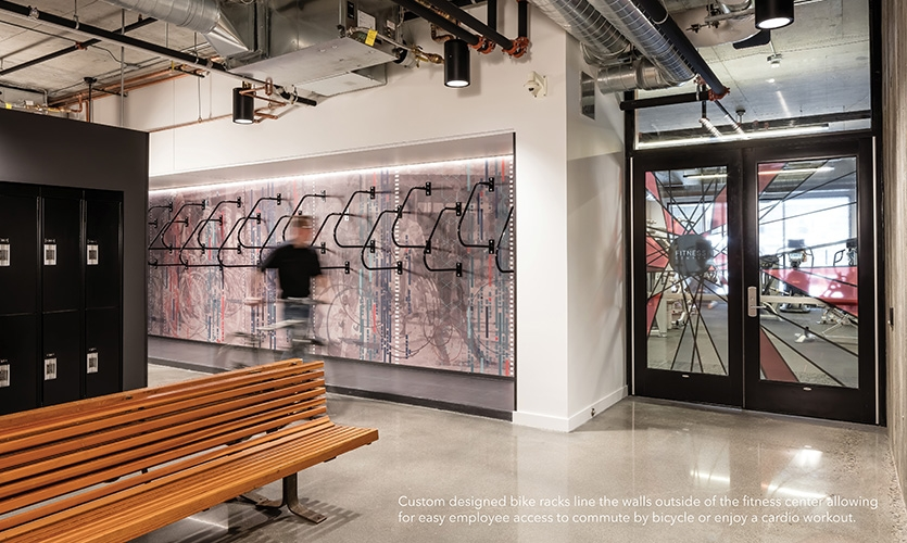 Custom-designed bike racks line the walls outside of the fitness center, allowing for easy employee access to commute by bicycle or enjoy a cardio workout