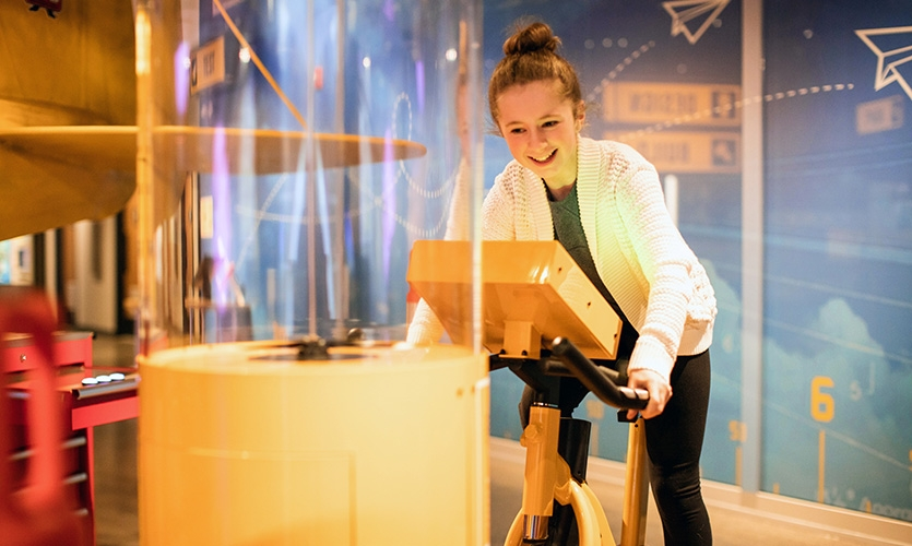 Visitors interact with hands-on STEM-based activities distributed around the gallery, and associated with science-related themes and messaging. This Bernoulli blower reveals how air currents flow.