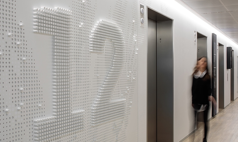 Lift lobbies feature integrated level numbers built from sections of painted dowel.