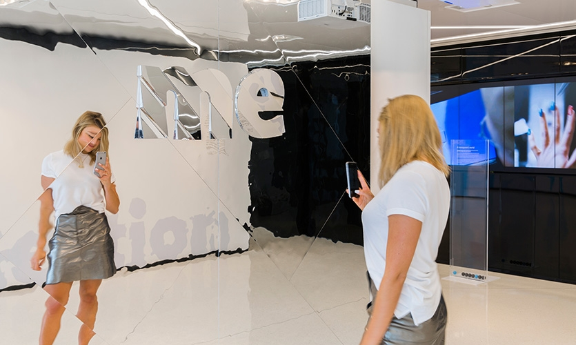 This mirror invited visitors to consider a selfie: Are we getting lost in our own reflection, or finding new ways to frame our personal brand?