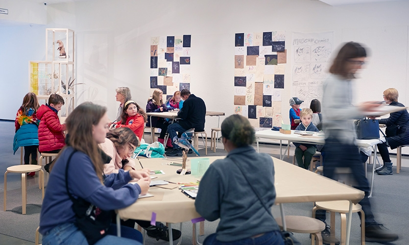 Visitors drawing. The lightweight tables made it easy for the educators and guest facilitators to rearrange the space for various needs.