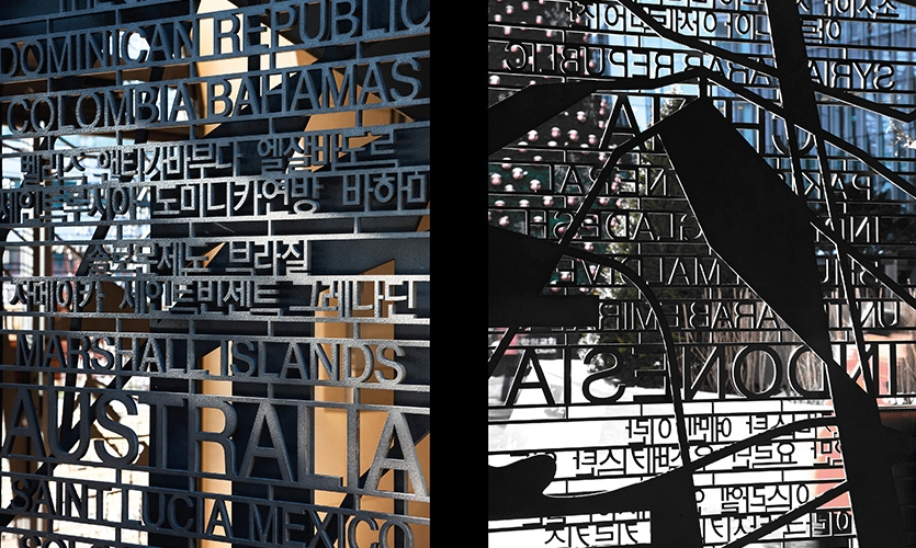 Each gate's text and graphic elements were laser cut from solid one-inch sheets of textured anodized aluminum.