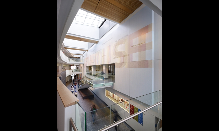 In the heart of the Newhouse III building, a 23- by 75-ft. typographic wall mural pays homage to the printing industry and more traditional means of communication.