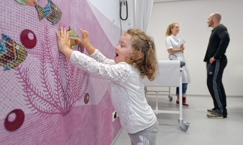 The experience is not limited to the narrative projections, but includes physical, hands-on objects such as magnetically fishes and playful elements in waiting areas