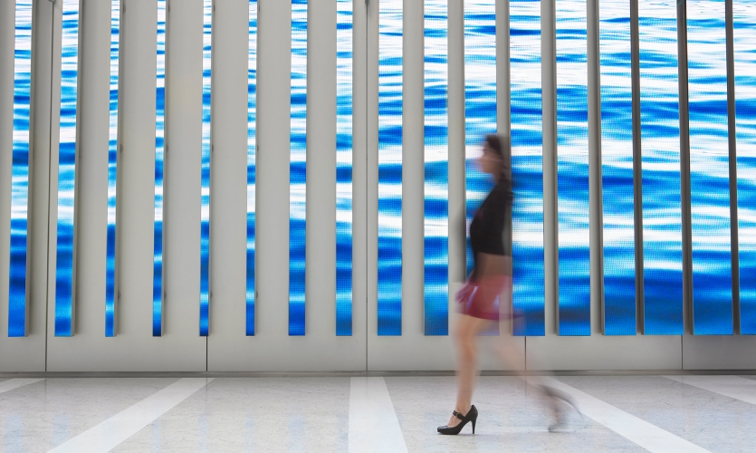 "The 3,000-square-foot, 16,000-pixel-wide digital canvas formed by 89 individual vertical LED ""blades"" of varying heights."