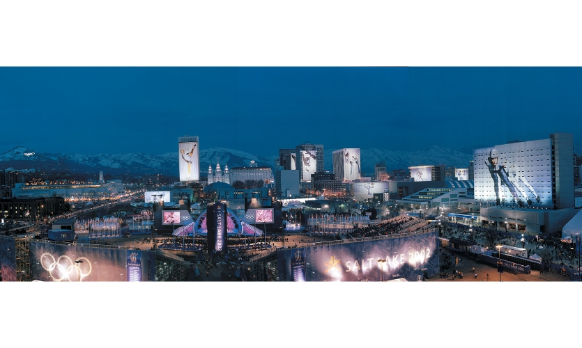 The XIX Olympic Winter Games were held in Salt Lake City in February 2002. The cityscape program Games illuminated the skyline with 14 building wraps, animated lighting projections and large-scale Olympic Rings glowing in the distant mountains.