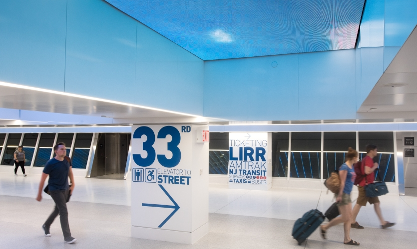 The program ranges from mural-like installations that cover 100-foot-long walls directing commuters into the concourse to 3-foot-high numbers identifying the individual tracks.