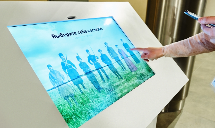 The second part of the exhibit includes a digital interface where visitors play virtual dress-up with Cossack uniforms from various eras, using their own photo.