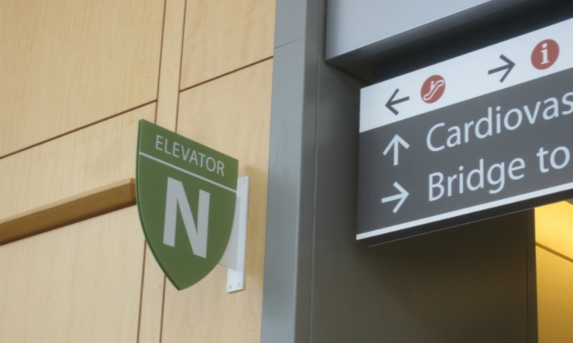 To reduce stress, CGA simplified signage on the hospital's main circulation spine.