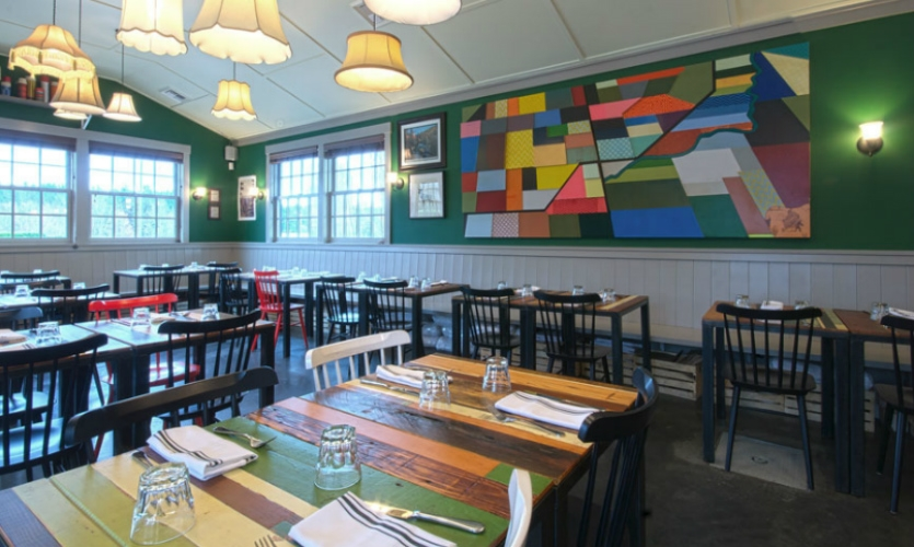 Hand-crafted mural and tables at Hollywood Tavern in Seattle