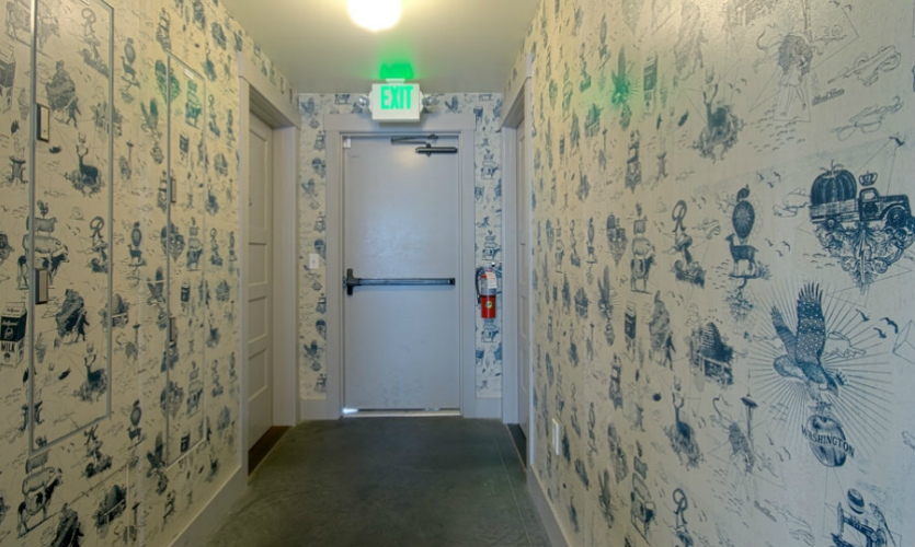 Custom wallpaper at Hollywood Tavern. Electric Coffin hand-paints and screens the designs on wood panels custom-fit to the environment.