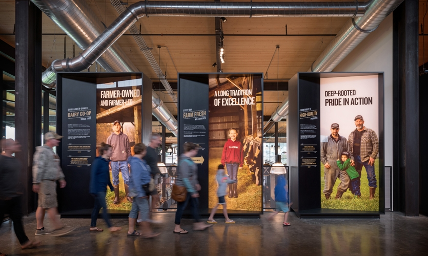 The exhibit bridge showcases six large-scale illuminated cases that serve to celebrate the important role of Tillamook's dairy farmers and Creamery workers.