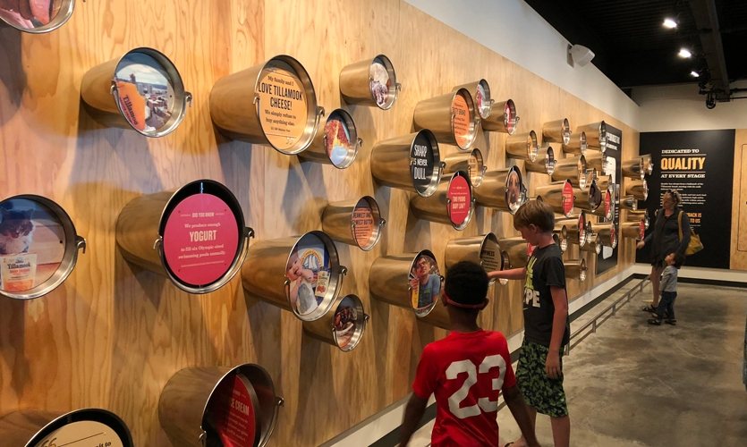 A playful installation of milk buckets with moveable storytelling components cements the connection between the Tillamook production cycle, commitment to quality, and the customer experience.