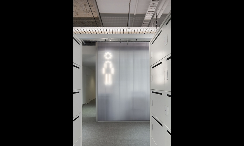 Staff amenity signage features custom designed pictograms that are illuminated behind translucent polycarbonate walls. (image: women's restroom sign)