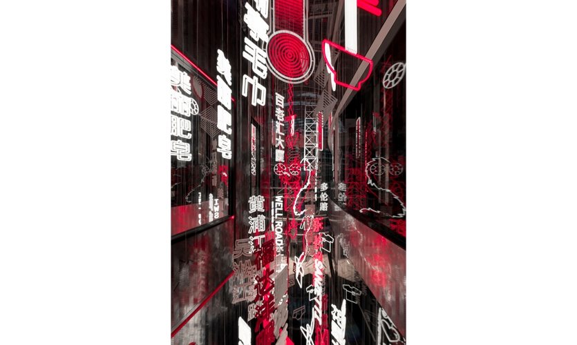 """On arrival, guests see a """"W Metropolis"""" created from bright lights and city towers hanging alongside a net of laundry and signage, all suspended at varying heights down a dramatic void."""