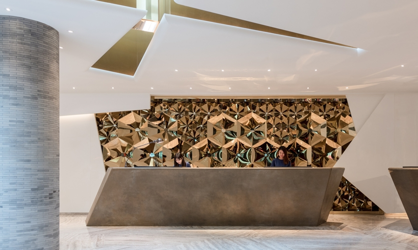 A mirror and brass kaleidoscopic installation occupies the reception. The custom design reflects the multitude of cultures and influences flowing through the area.