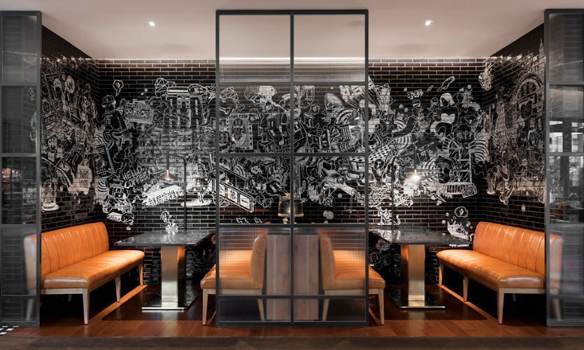 """Local artist Coozie created the vast white mural on black handmade tiles, titled """"Honghou Tales"""" commemorating legends of the past 110 years of the Hongkou District."""