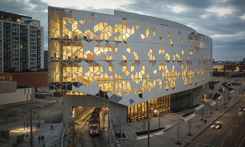 The grid and shapes are derived from the facade pattern. A rationalization of the shapes creates a flexible system which adapts to the different needs throughout the library. (image: facade)