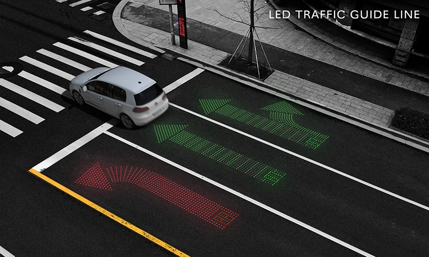 Keep visible-LED TRAFFIC GUIDE LINE (image: LED lane arrows embedded into street)