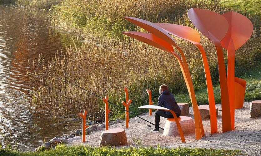 The angling and rest spots are an interpretation of an aquatic plant, the Bog Arum (Calla palustris) that one finds on lake shores.  (image: orange fishing pavilion)