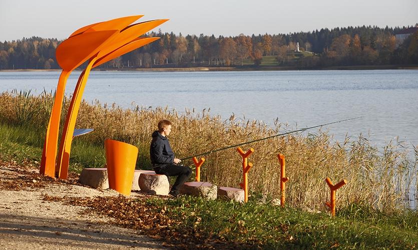 Angler's Seats  (image: man fishing at orange fishing pavilion)
