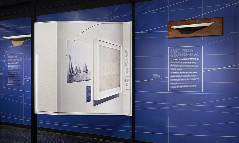 """Lighter, Stronger, Faster: The Herreshoff Legacy""  (image: exhibit featuring boat design)"