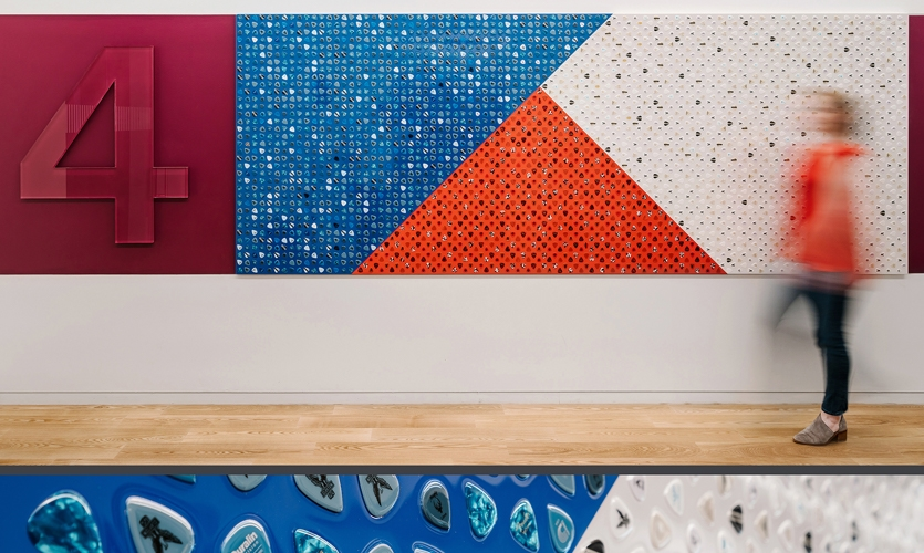 Elevator lobbies display abstract references to the Texas flag, each made from re-appropriated materials. This piece on a music-themed floor includes 4,560 guitar picks—and many layers of clear coat.