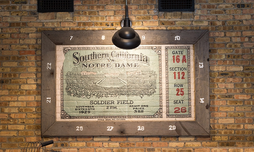 1929 vintage ticket graphic using re-purposed redwood bleacher seats from the original stadium for frames. (image: mural framed in wood)