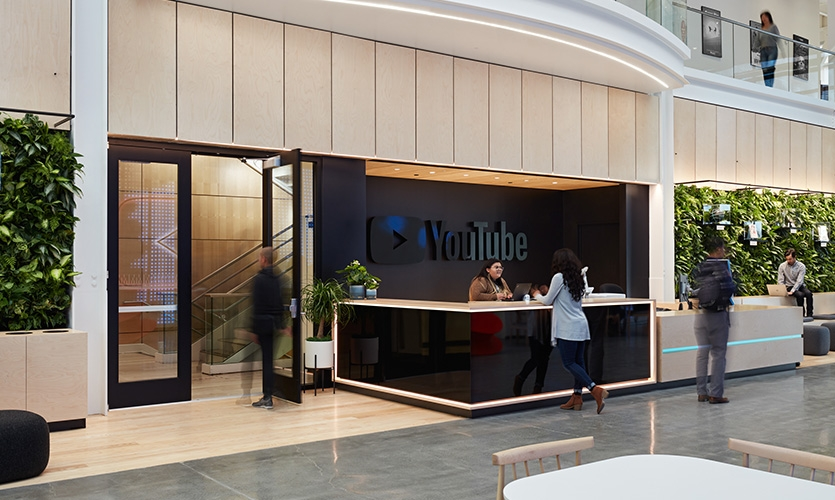 View of the reception with YouTube's sign reflecting the digital wall display