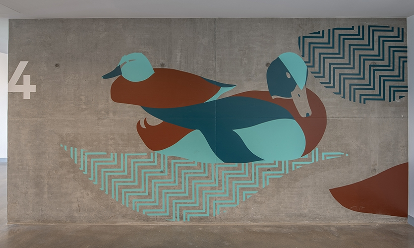 """Artwork features the Cinnamon Ducks of elewexe (Paso Robles) and the graphic pattern element represents the Salinas River """"highway"""""""
