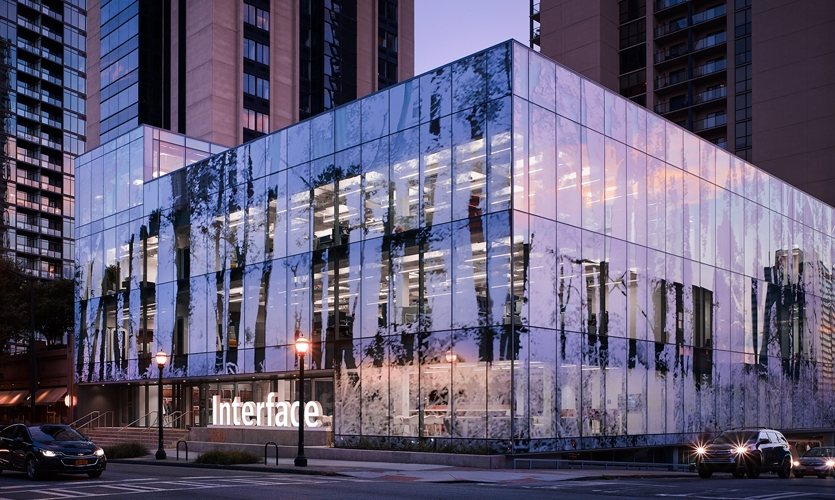 Corner view of Interface Inc.'s new headquarters in Midtown Atlanta (Night)