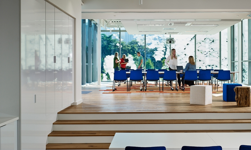 Interior view of the 6th floor at Interface Headquarters depicting common space with designed façade beyond.