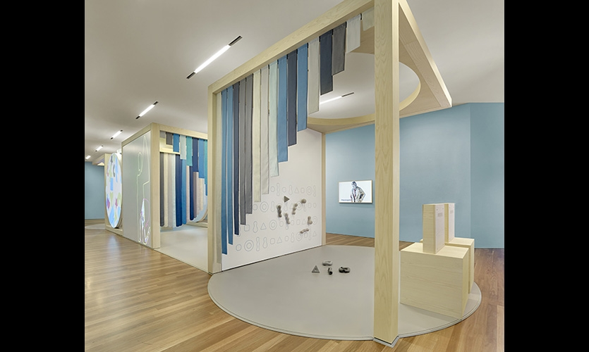 Form and Structure Module. (image: exhibit area with cascading blue fabric)