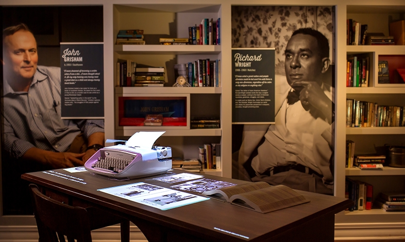Embedded in the reproduction of a writer's studio—the study—the typewriter experience uses projected videos precisely mapped to a real desk, typewriter and book. (image: exhibit)