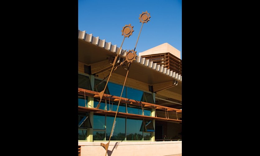 Long eaves block the summer sun but allow winter sun to warm the interiors. Steel sculptures designed by AldrichPears Associates indicate the sun's angle at summer and winter solstices.