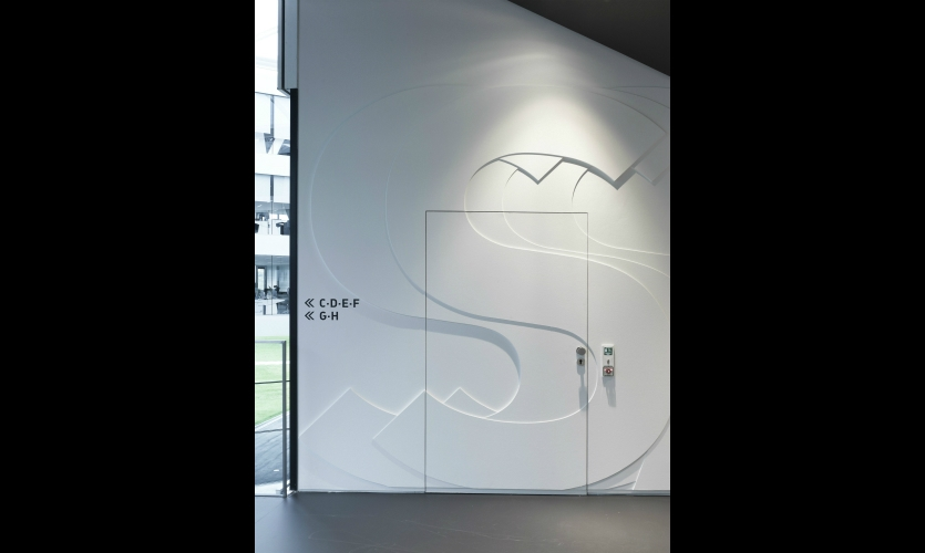 Wayfinding signage is integrated with the dimensional graphics.