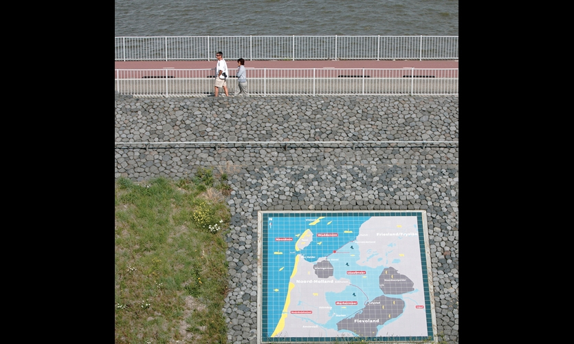 A 20-ft.-square tile map embedded in the dike lends geographic perspective on the Netherlands and its dike system.