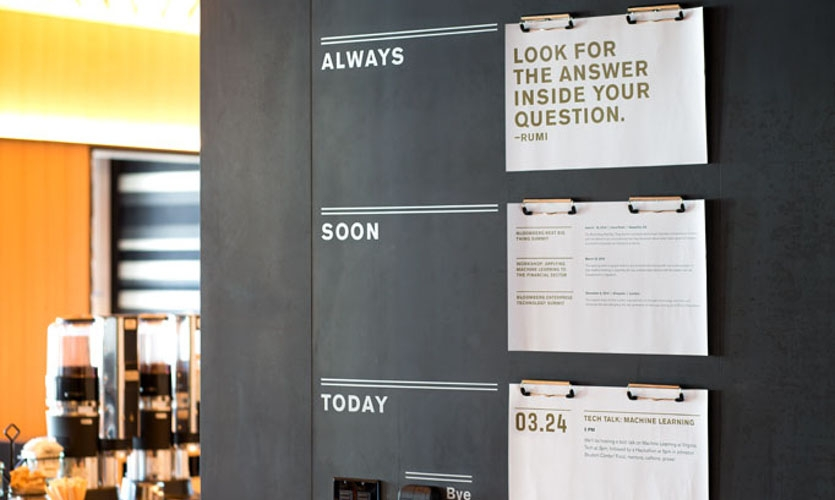 Metal clips attached directly to the wall allows Bloomberg staff to post announcements and inspirational material.